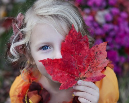 girl with fall leaf